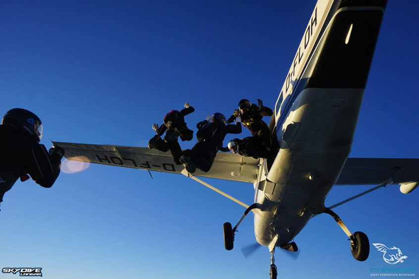 5 skydivers exit the aircraft