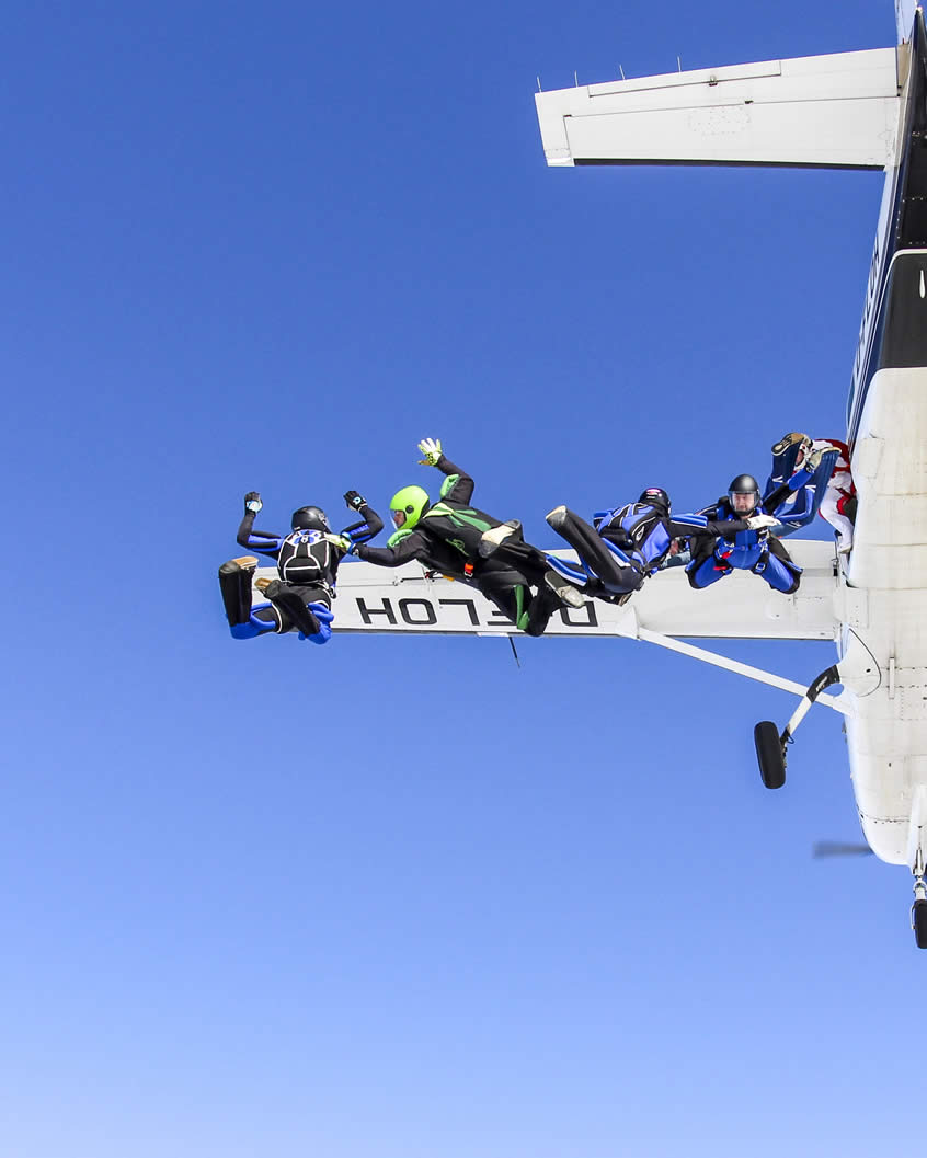 Skydivers jumping out of plane