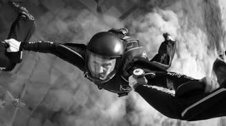 Black and white skydiver in freefall