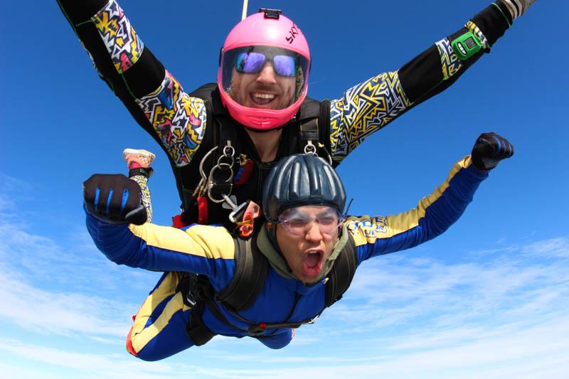 Smiling tandem skydiver