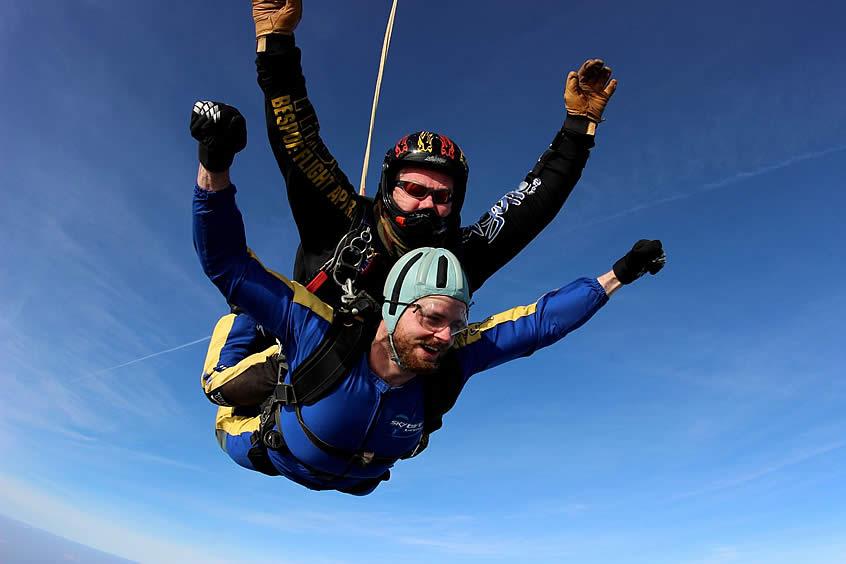 Excited tandem skydiver