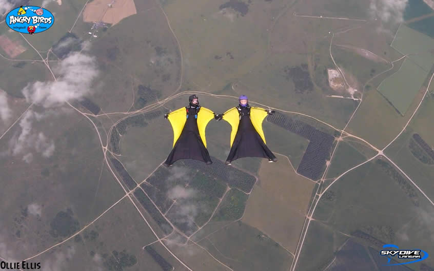 2 Wingsuiters skydiving above Langar airfield